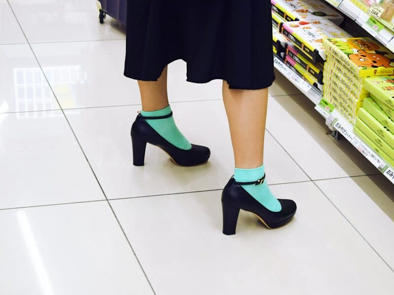 shot of girl wearing black heels with blue socks