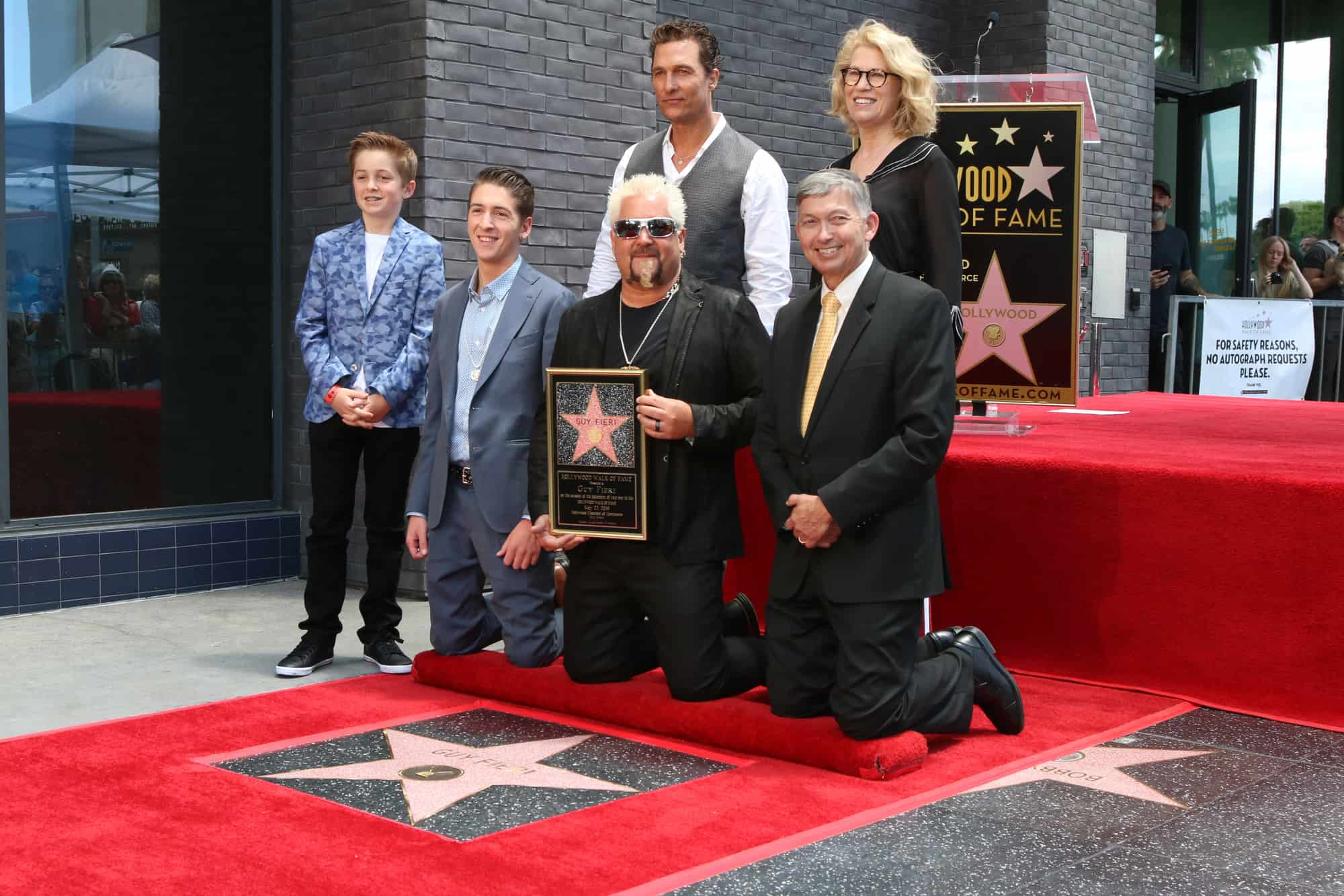 Guy Fieri and family gather around for the ceremony of Guy Fieri's Hollywood star