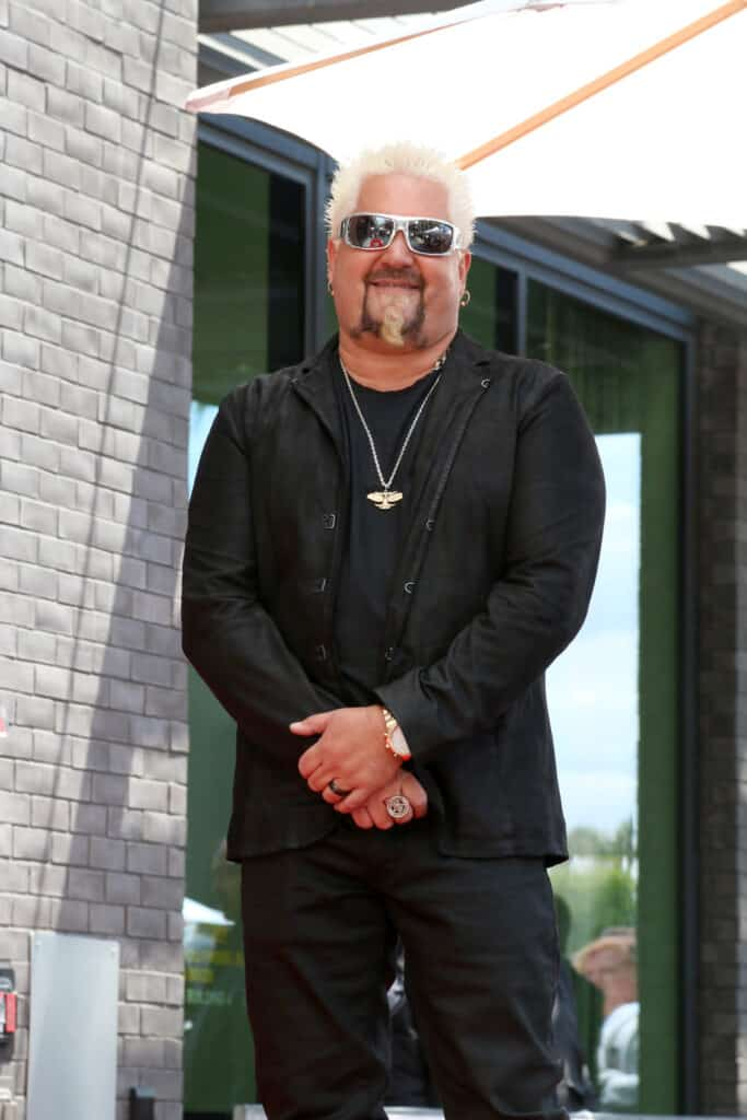 picture of guy Fieri standing in black suit