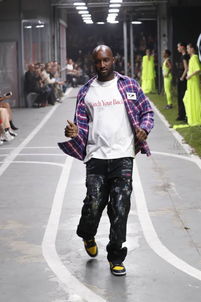 LV menswear creative director, Virgil Abloh, walking down runway in Paris