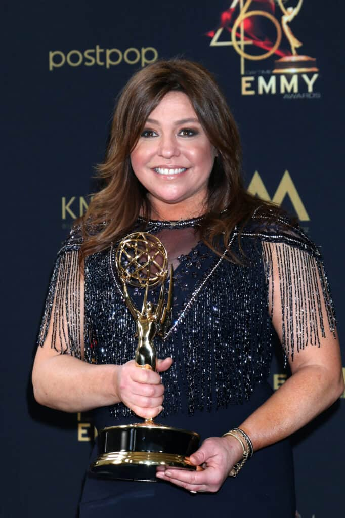 Rachael Ray at an awards event holding trophy