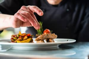 chef placing final touches on a dish