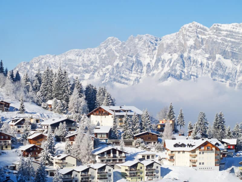 shot of switzerland village and alps