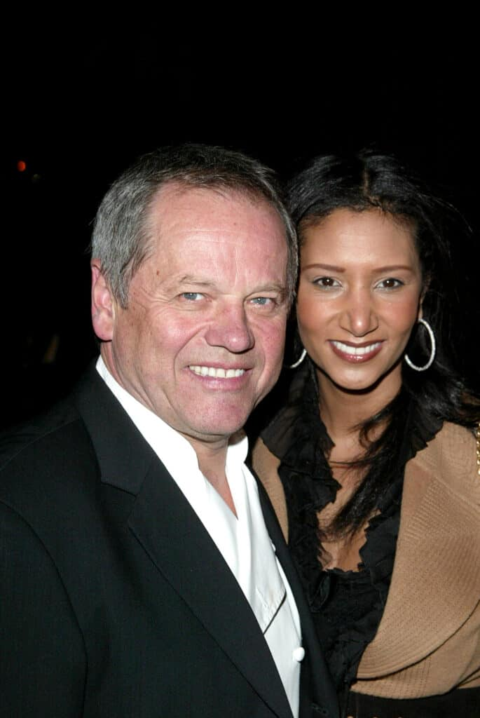 Wolfgang Puck and his guest at an event