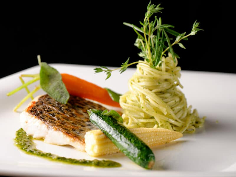 Fine dining, Trout fish fillet breaded in herbs and spice with basil pasta