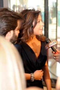 Rachael ray answering questions at an event