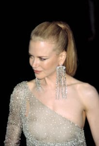 Nicole Kidman wearing chandelier earrings at an event