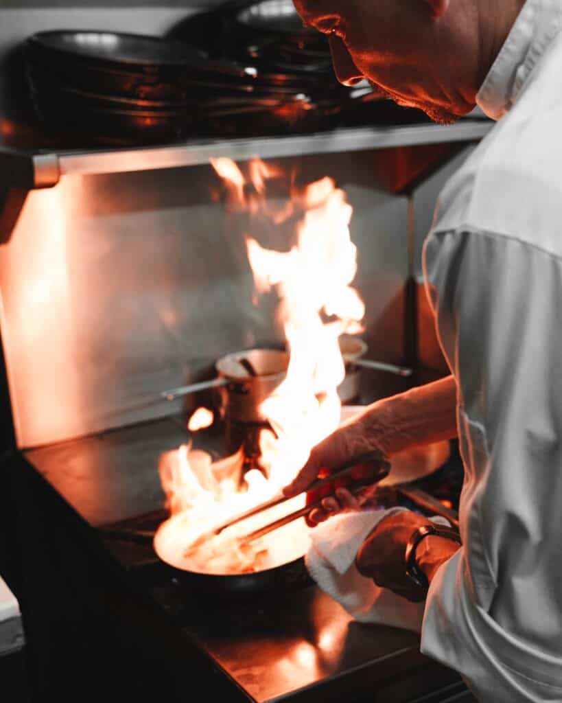 Chef cooking over open fire