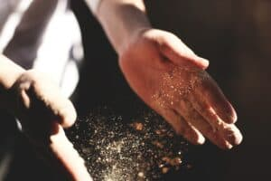 chef throwing spices on a dish