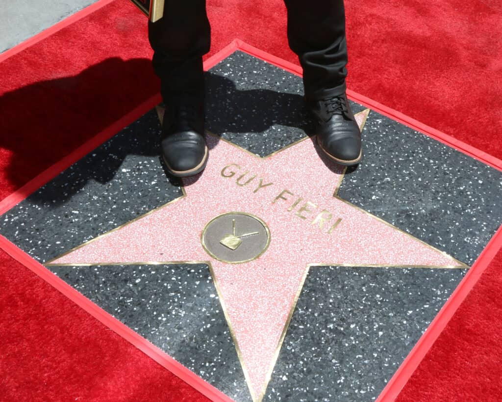 Guy Fieri feet on his Walk of fame star at the Guy Fieri Star Ceremony on the Hollywood Walk of Fame on May 22, 2019 in Los Angeles, CA