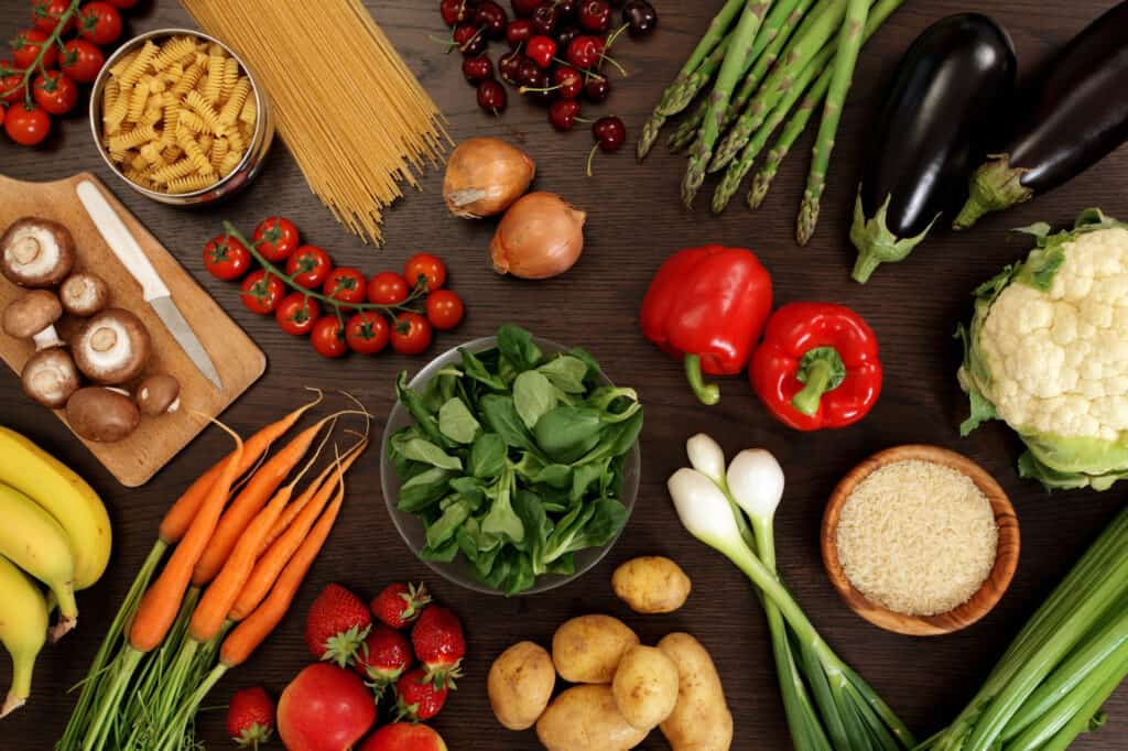spread of various fruits and veggies on table