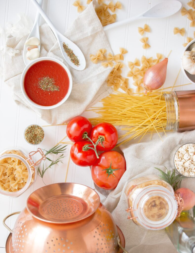 Table full of different pasta ingredients