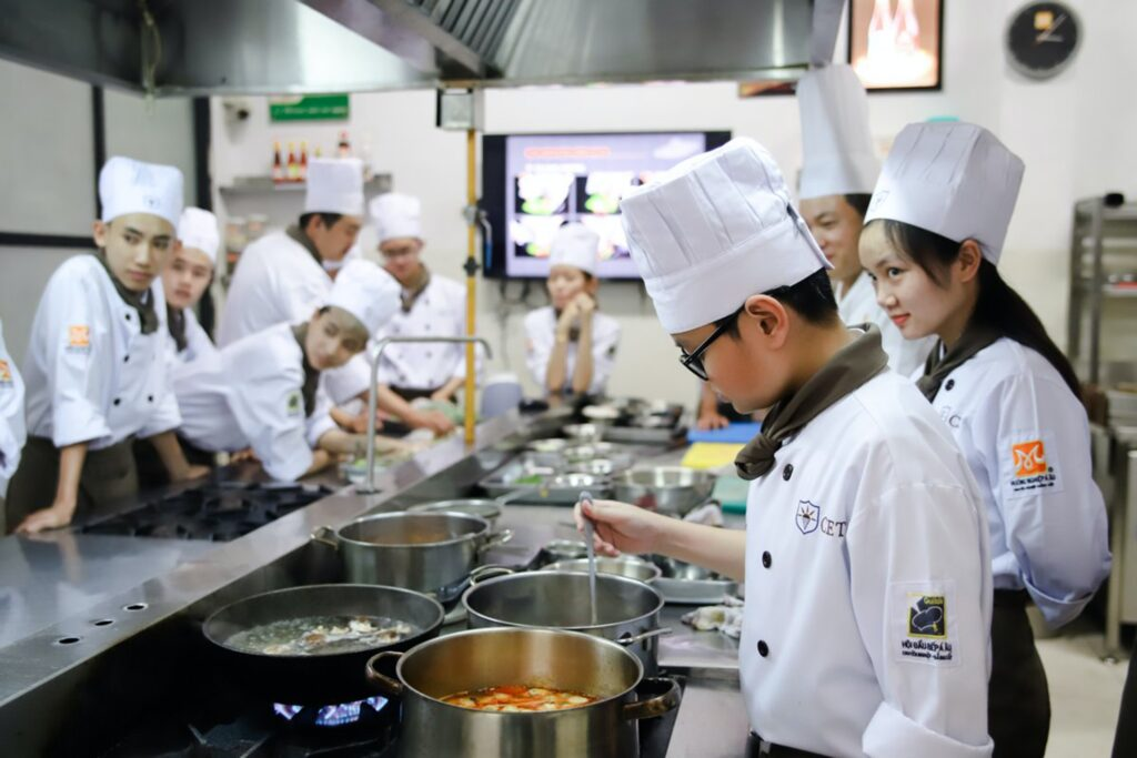 Multiple chefs working together in a restaurant kitchen