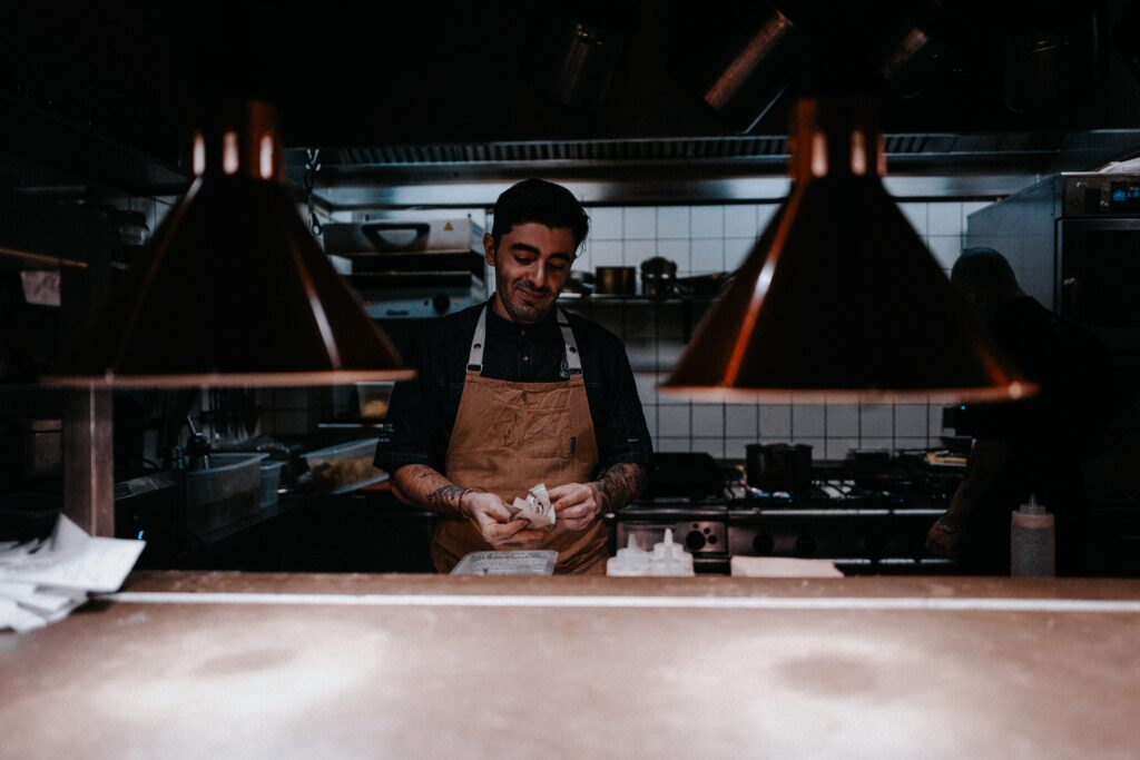 Chef working alone behind a kitchen counter