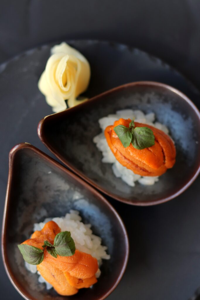 Two sushi rolls sitting in small bowl