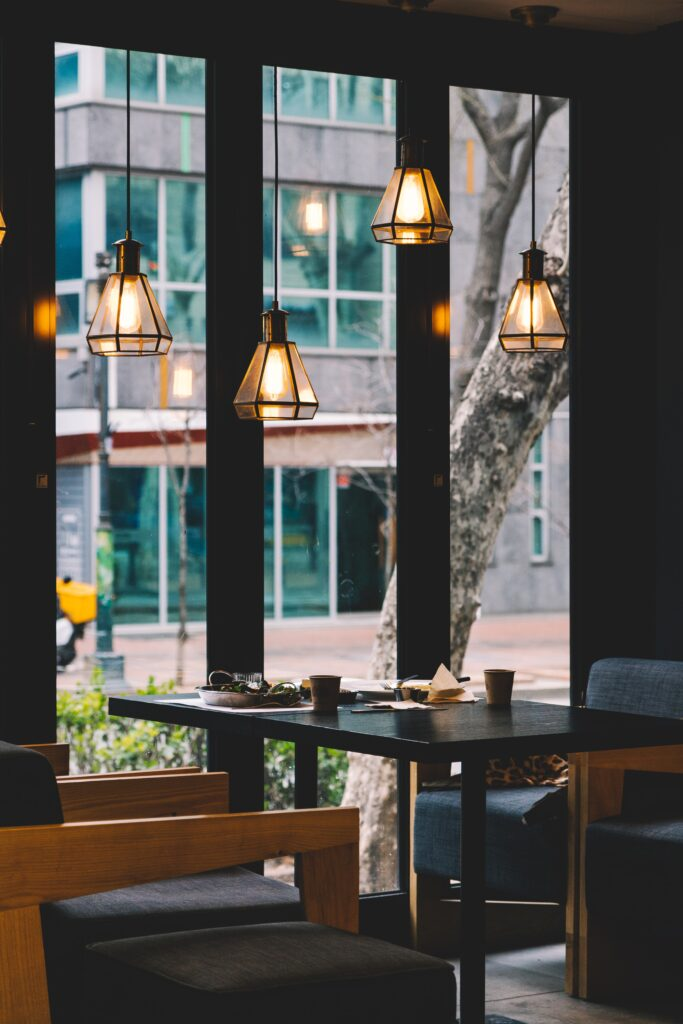 Small table for two in a fancy restaurant facing a window
